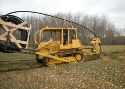 Plow with pipe loaded for plowing in main line